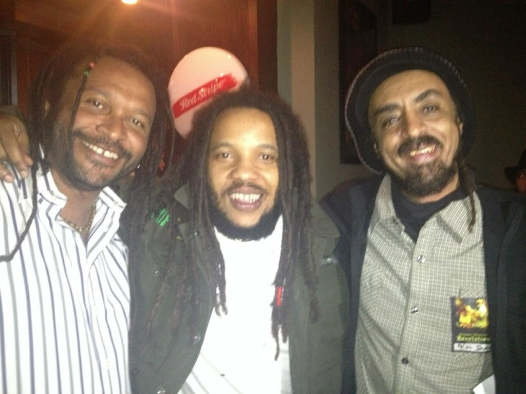 L to R: Wild Hare partner Joel McCarthy with Stephen Marley (center) and partner Asrat Sellassie this week before Marley's show at the Double Door