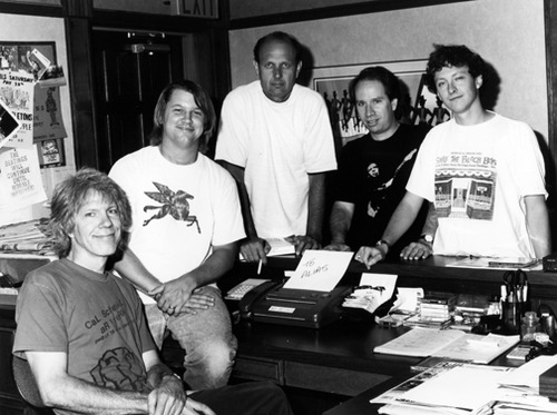 The Skeletons sign a fancy pants record contract (L to R), Bobby Lloyd Hicks, Joe Terry, Lou, D. Clinton Thompson, Kelly Brown