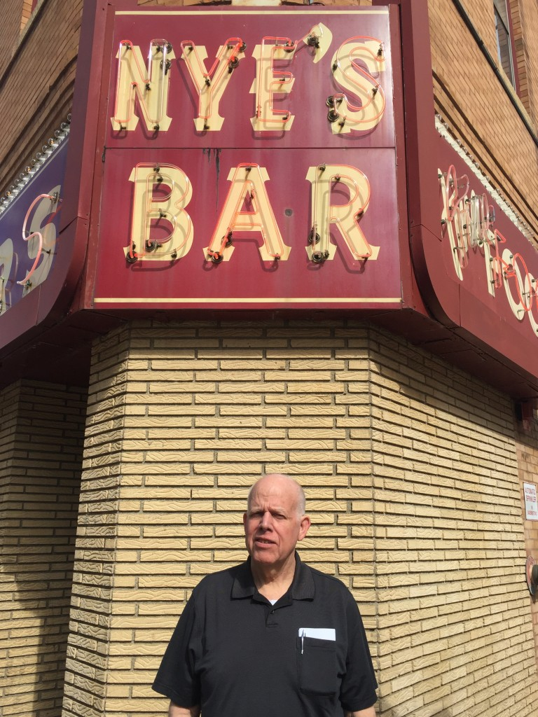 Phil Barker in daylight in front of the original bar.
